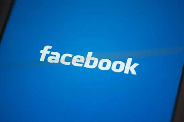Facebook logo in white color against blue background
