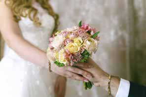the groom presents a bride's bouquet