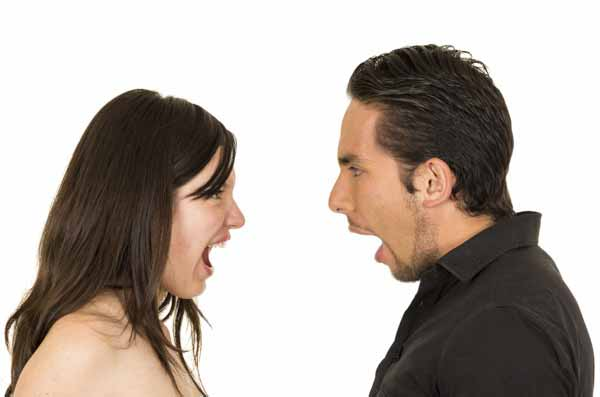 young attractive couple fighting screaming to each other