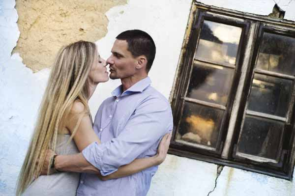 Couple in love in front of an old house
