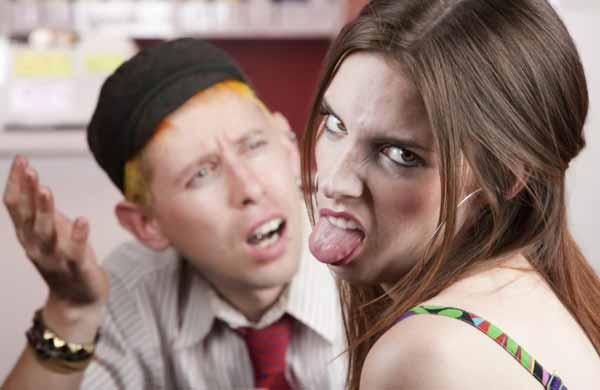Young woman making rude gesture on a bad date