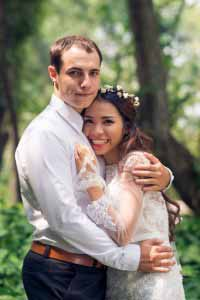 Happy hugging groom and bride