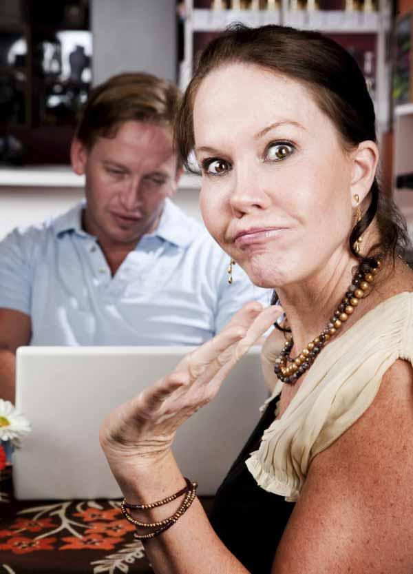man  ignoring his pretty date