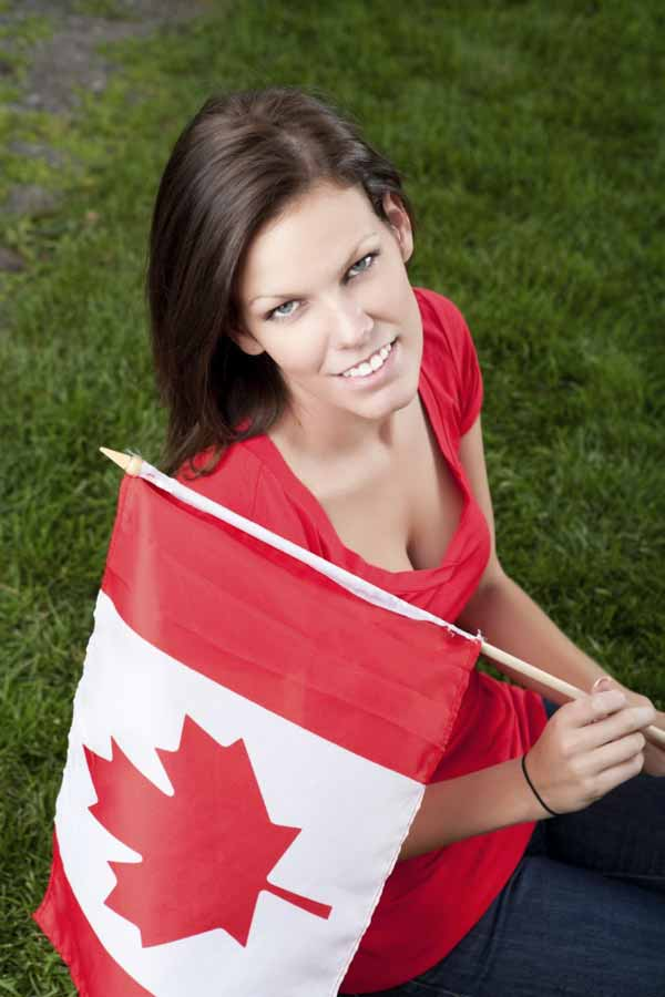 Smiling Canadian Girl with national flag