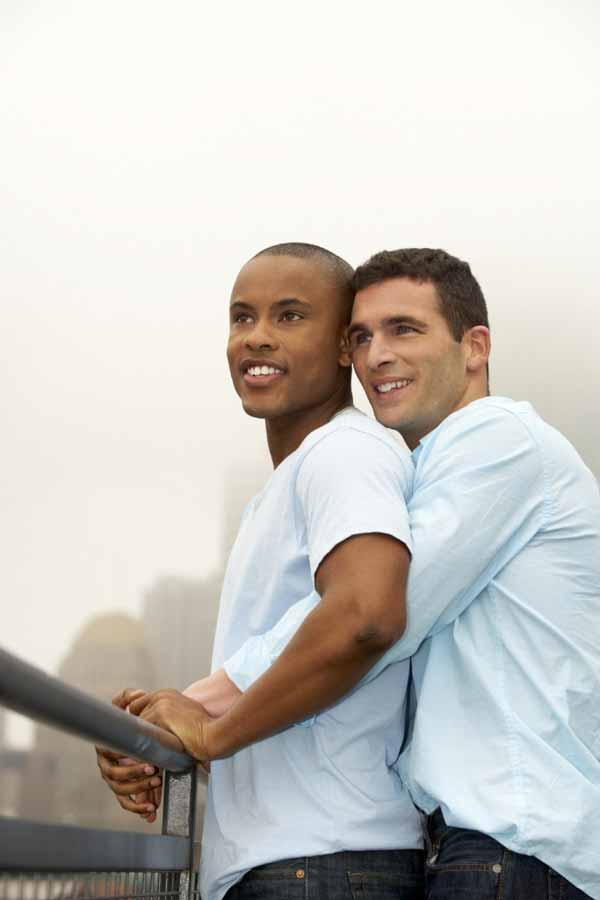 Happy hugging gay couple