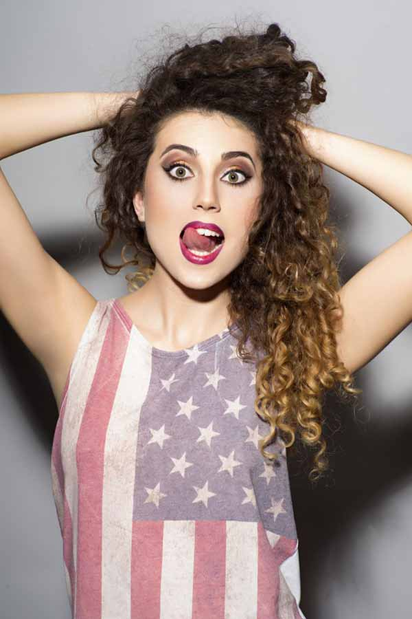 crazy girl with curly hair in american flag printed shirt