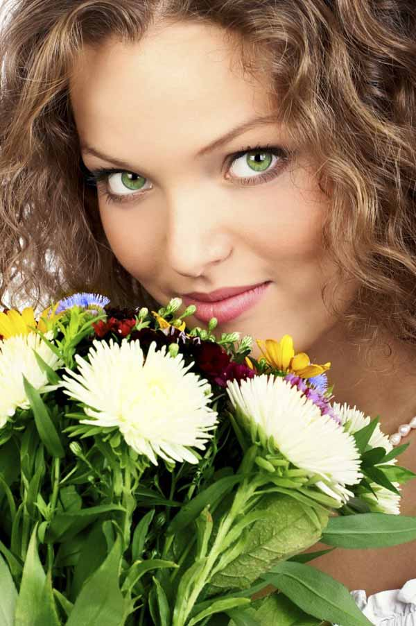 oung smiling woman with bunch of flowers