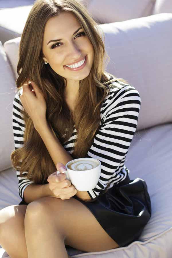 Young Slavic Woman drinking coffee