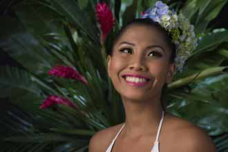 Beautiful Filipina young woman with flowers in her hair