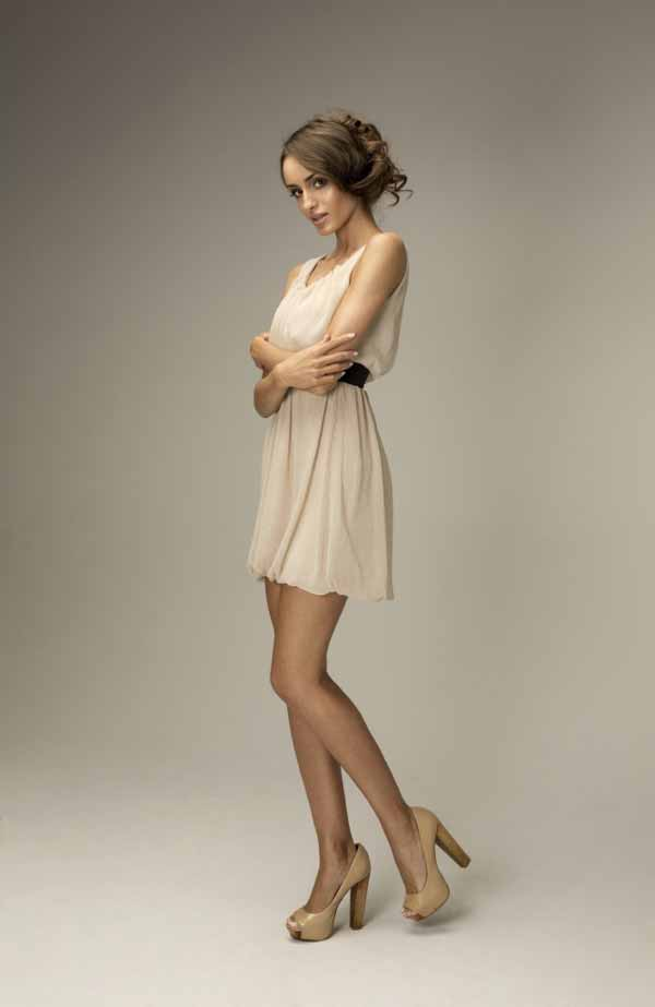 Slavic woman wearing fashion dress and shoes