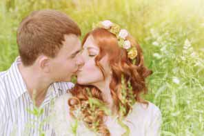 beautiful young couple kissing outdoors