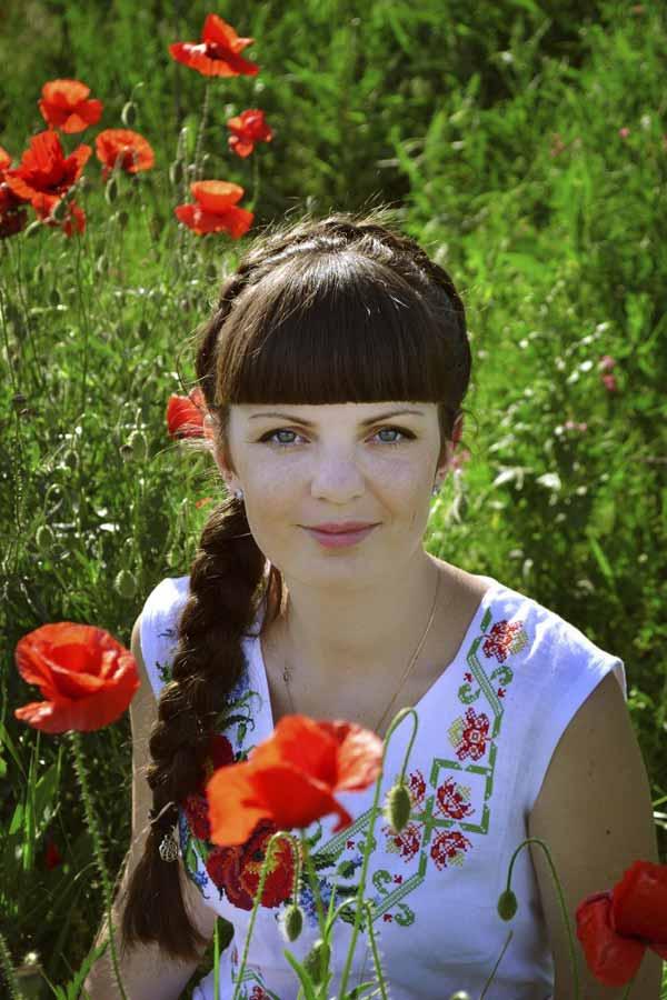 Beautiful Ukrainian woman in the fieldof flowers