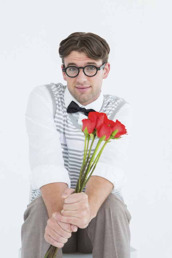 a nerd holding flowers