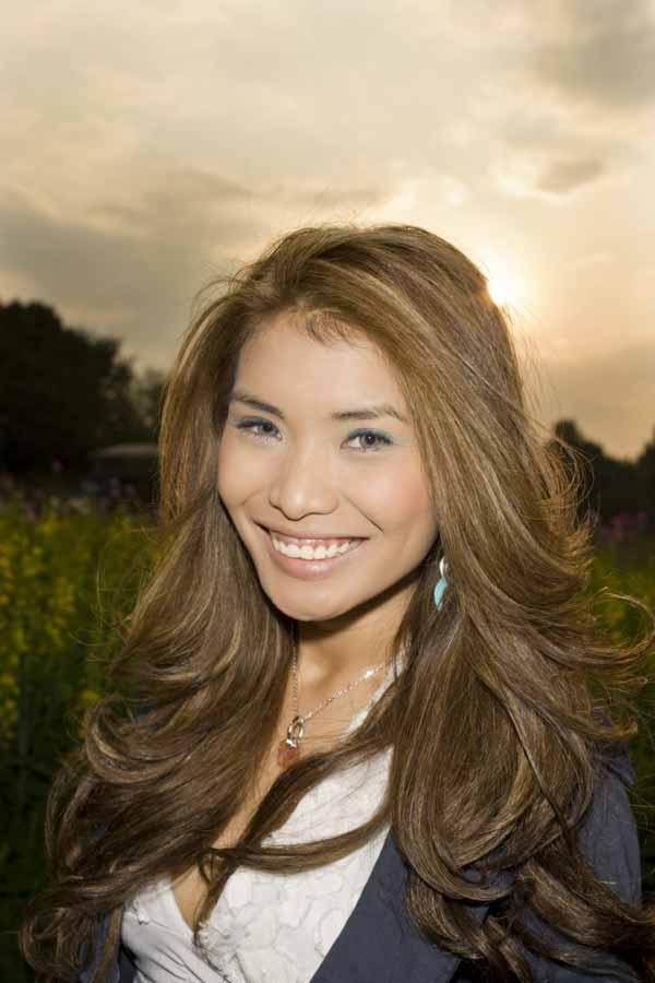 Smiling Filipina Female at sun set