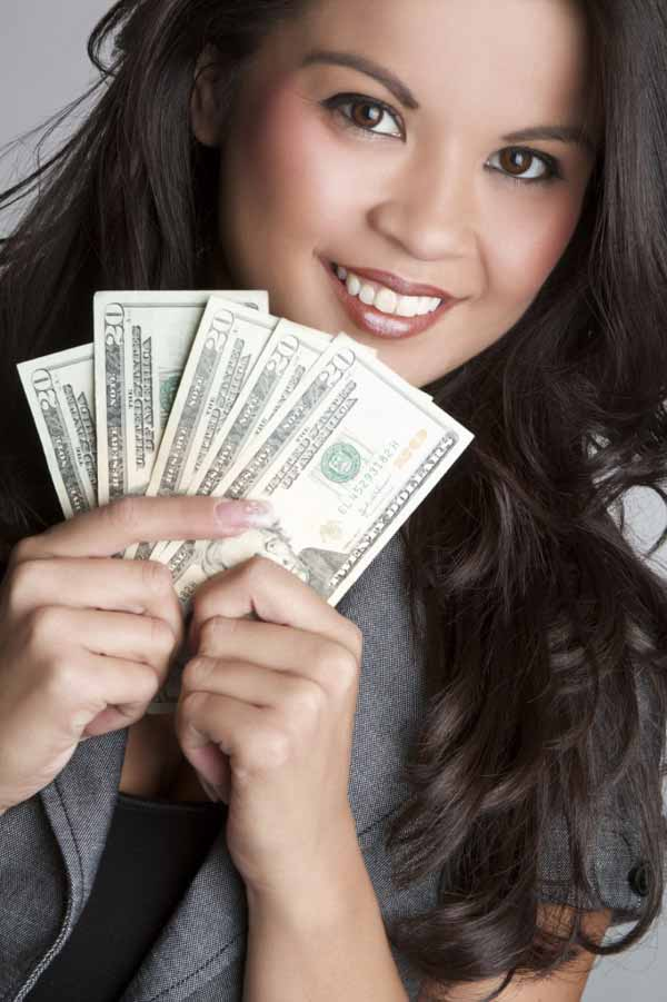 Smiling Filipino woman with money