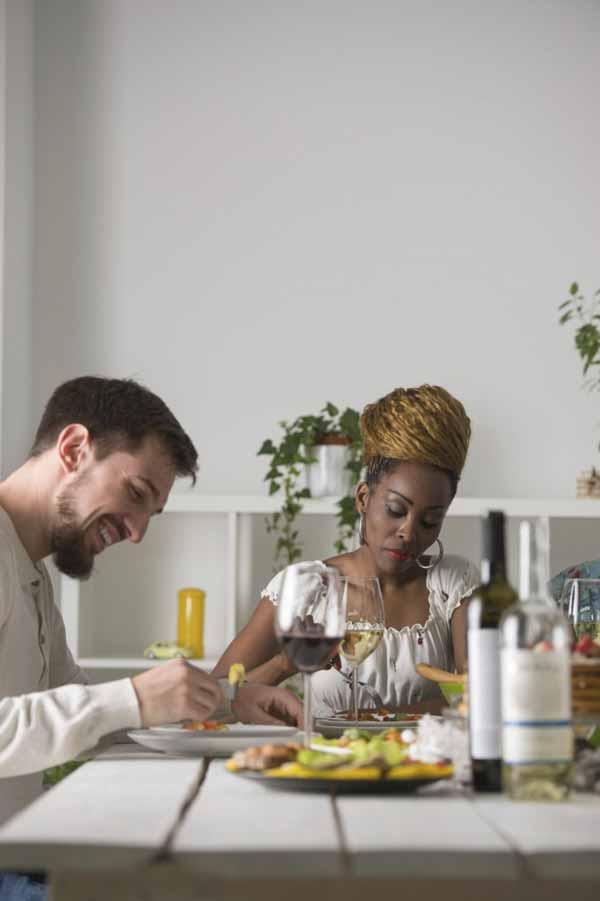 Young Multiracial Couple Enjoying Meal