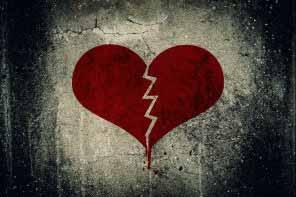 Heart broken painted on grunge cement wall