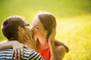 Romantic young couple hugging and kissing
