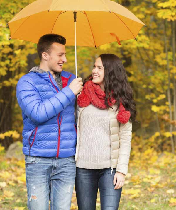 smiling couple with umbrella