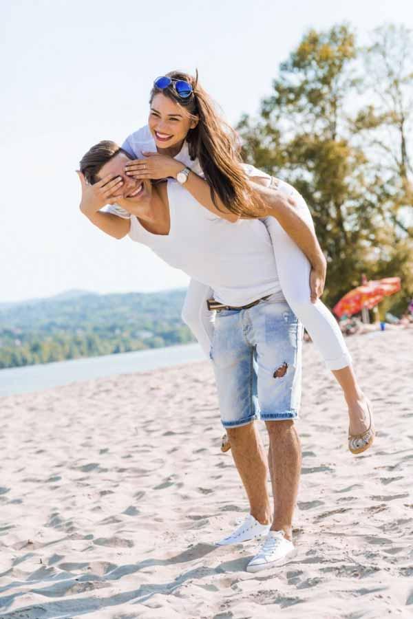 handsome man carrying his girlfrien