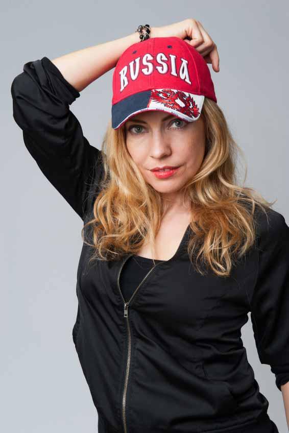 Beautiful young woman in a baseball cap.