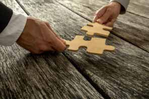 a business people presenting a matching puzzle piece
