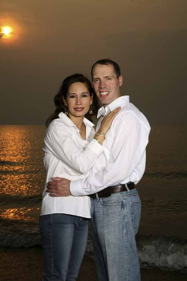happy interracial couple on the beach