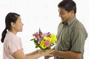 woman receiving a bouquet of flowers.