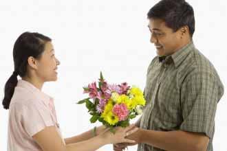 woman receiving a bouquet of flowers.