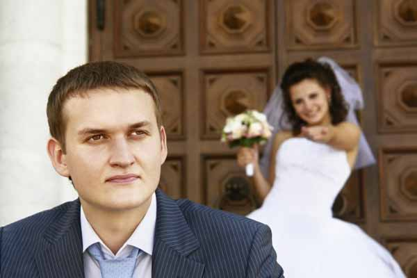 Bride with the groom on the church background.