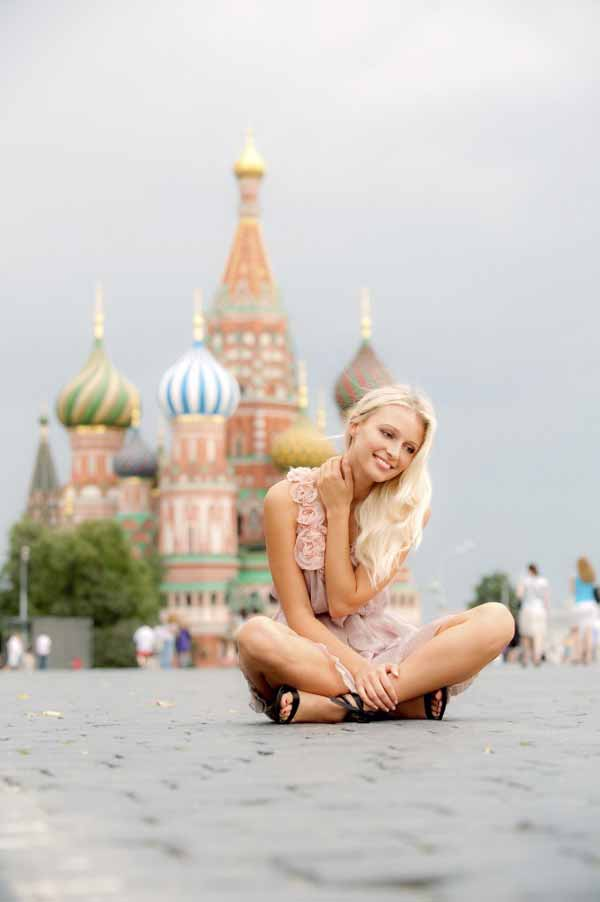 Charming blondeon Red Square in Moscow.