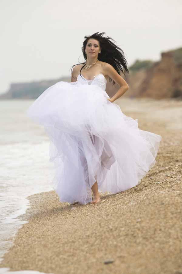 Russian Bride running on the Beach