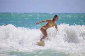 girl surfing in Hawaii