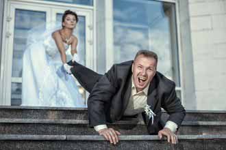 Bride dragging groom at the wedding.