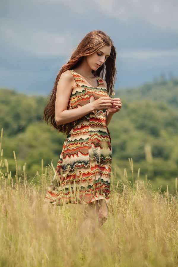Russian woman walking in field.