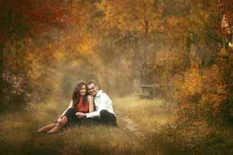happy couple sitting hugging