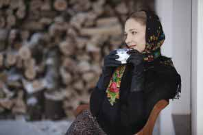 Russian woman traditional scarf with cap of tea