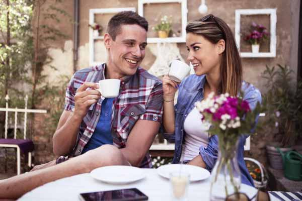 smiling couple on a first date in a cafe