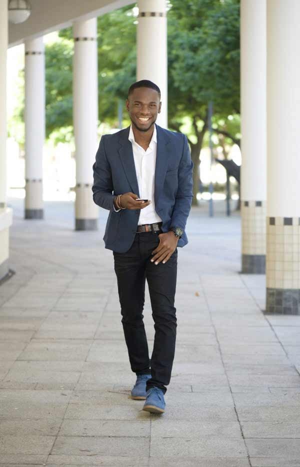 cool black guy walking with mobile phone