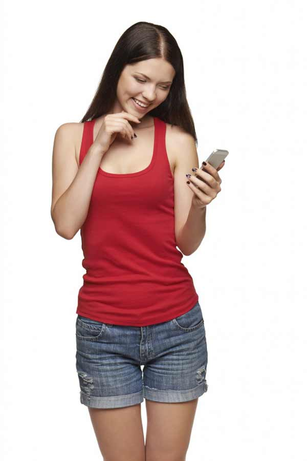 happy woman reading a sms on cell phone