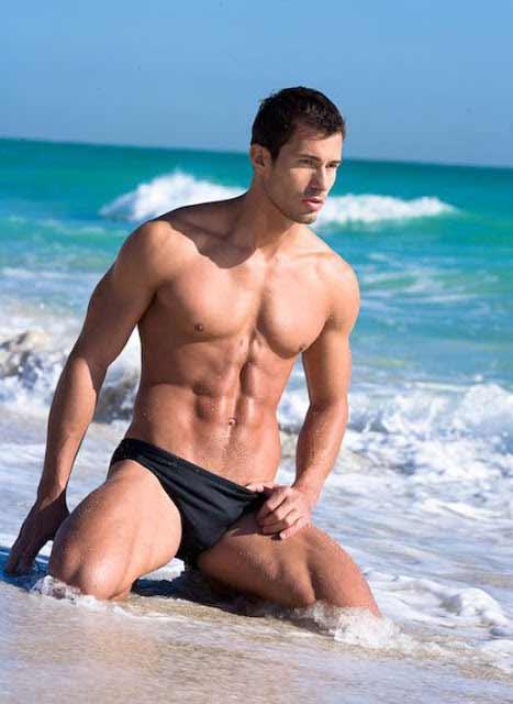 sexy gay on the beach shore