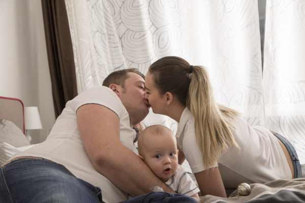 Happy family with their child.