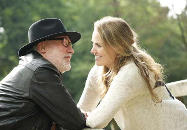 a mature man with young woman