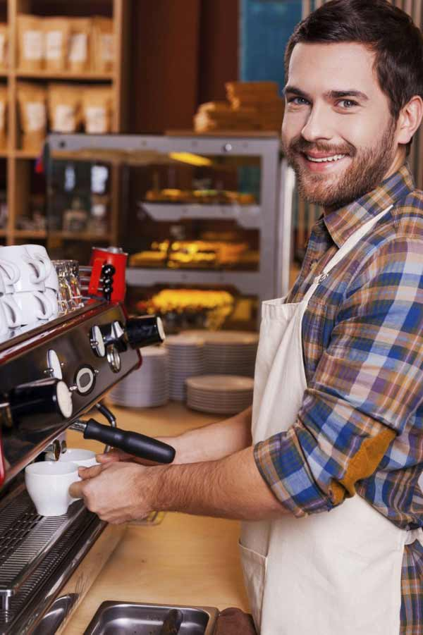 male barista making coffee