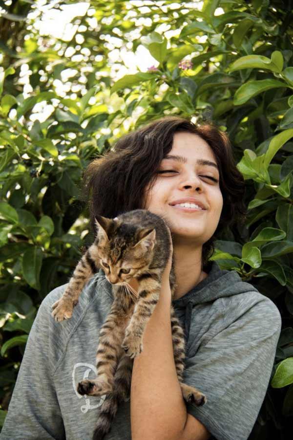 smiling girl holding cat