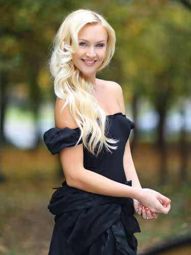 a gorgeous blonde Bealrus woman in black dress