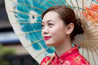 a beautiful Chinese woman in national red dress