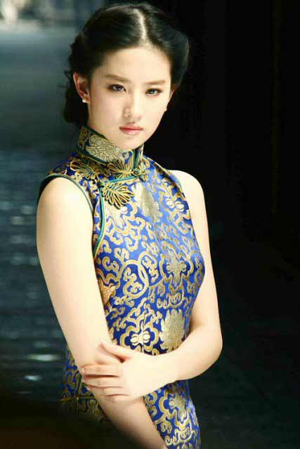 a beautiful Chinese woman in a traditional national dress
