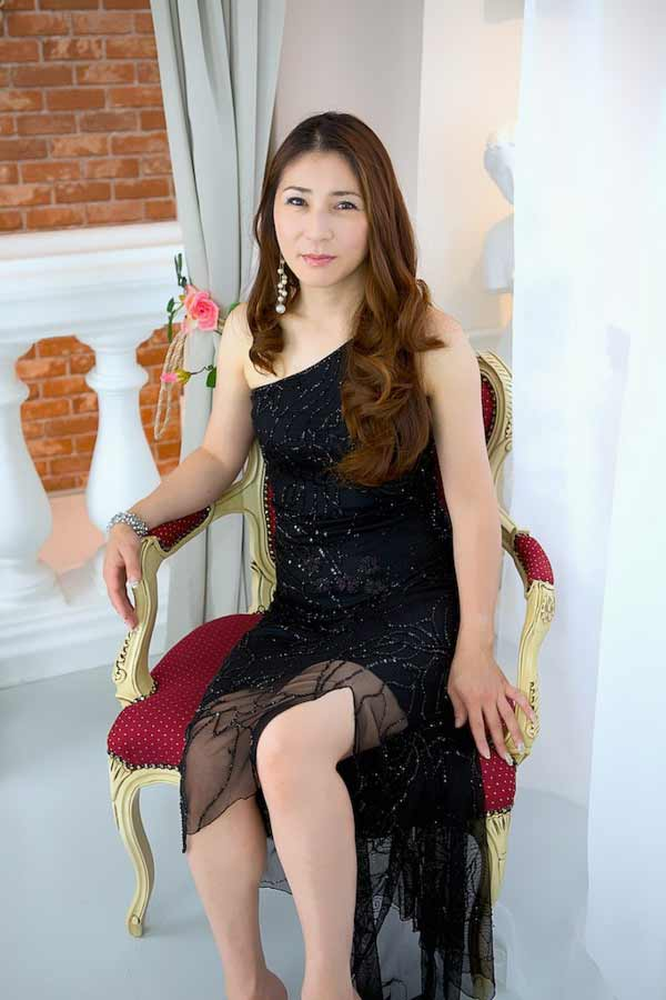 Japanese woman wearing black dress