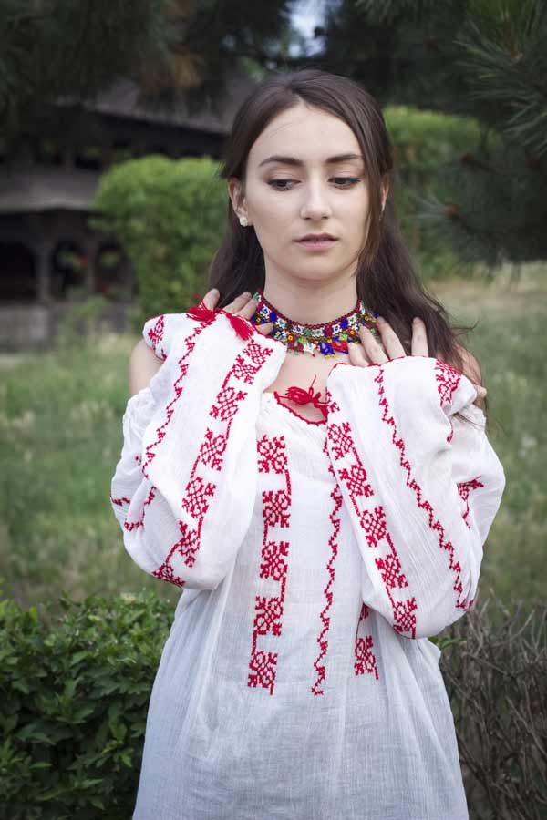 A young Romanian girl dressed traditionally